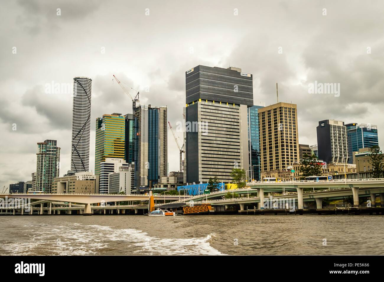 Brisbane skyline seen from a boat on the river - Stock Image