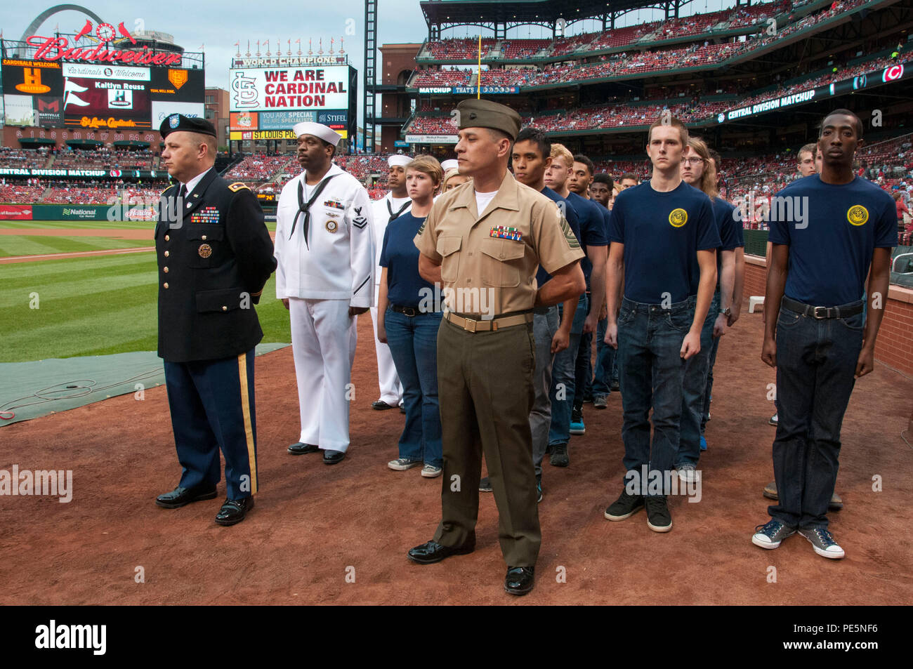 150926-N-II118-034 ST. LOUIS (Sept. 26, 2015) – Service members and Delayed Entry Program participants from St. Louis Military Entrance Processing Station (MEPS) wait to take part in a joint oath of enlistment ceremony in recognition of the St. Louis Cardinals annual Military Appreciation Day. Seventy-three MEPS applicants participated in the event. (U.S. Navy photo by Mass Communication Specialist 1st Class Latrice Jackson/Released) Stock Photo