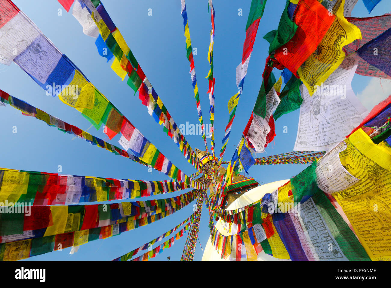 Colorful Prayer Flags with mantras that are believed to be carried by the wind to spread blessings to the world - Stock Image