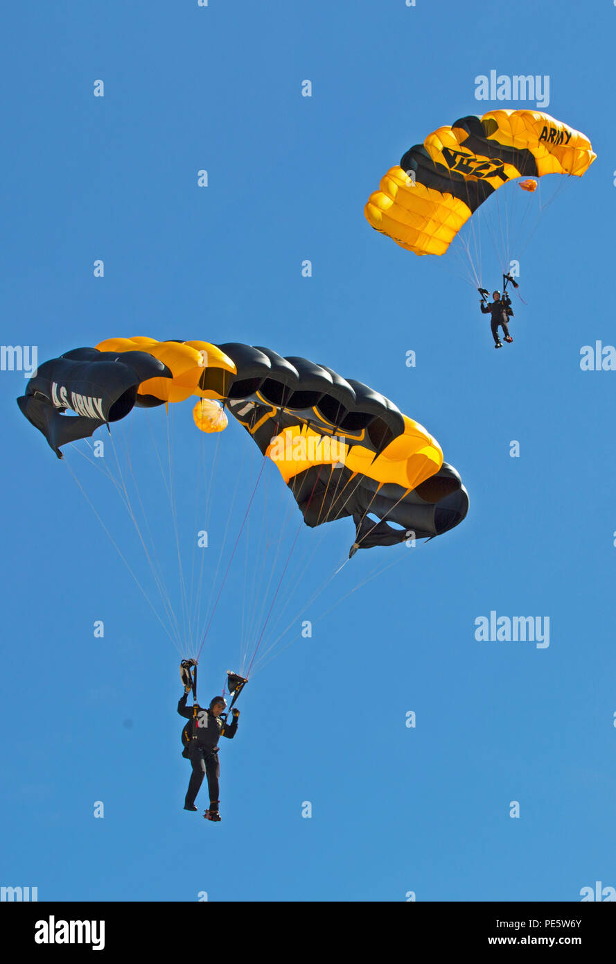 The Army's Golden Knights parachute team performs during the 2015 MCAS Miramar Air Show aboard Marine Corps Air Station Miramar, Calif., Oct. 2. The demonstration team jumps from more than 12,000 feet onto a target on the ground. (U.S. Marine Corps photo by Sgt. Uriel Avendano/Released) - Stock Image