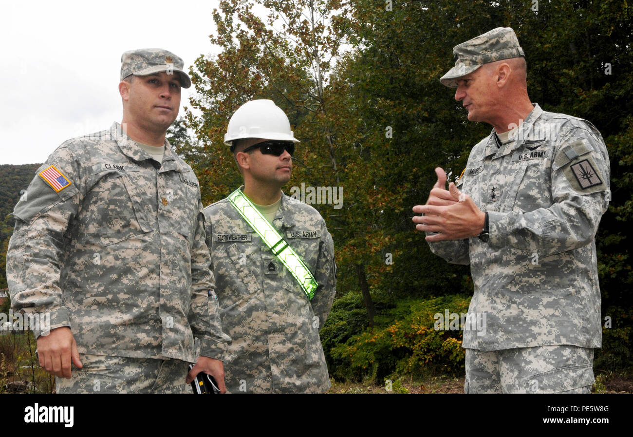The adjutant general of  New York, Maj. Gen. Patrick A. Murphy, discusses debris removal strategy with Maj. Chad Clark and Sgt. 1st Class Bryan Starkweather, of the 204th Engineer Battalion, along Esopus Creek in preparation for Hurricane Joaquin, Oct. 2, 2015. The National Guard engineers worked with the New York State Department of Environmental Conservation to remove debris from creeks, which could flood in heavy rainfall. (New York Army National Guard photo by Sgt. Michael Davis/Released) Stock Photo