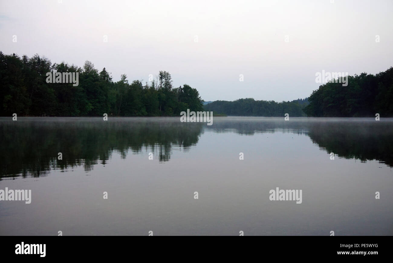 fog at mountain lakein the morning - Stock Image