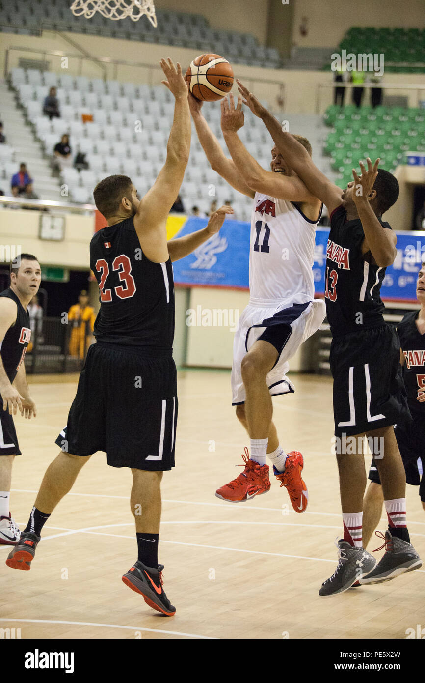 U.S. Men's Basketball Team player Matthew Holland jumps to shoot the ball at the U.S. basketball game against Canada during the 2015 6th CISM World Games. The CISM World Games provides the opportunity for the athletes of over 100 different nations to come together and enjoy friendship through sports. The sixth annual CISM World Games are being held aboard Mungyeong, South Korea, Sept. 30 - Oct. 11. Stock Photo