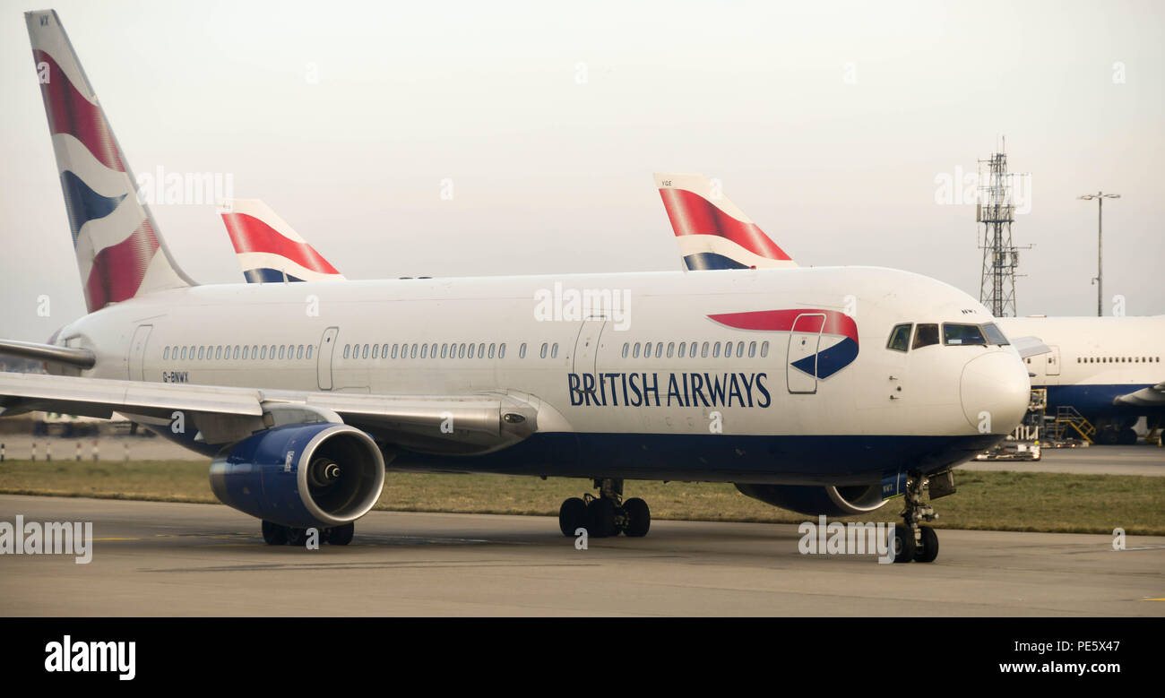 British Airways Boeing 767 long haul airliner taxiing for take off at London Heathrow Airport - Stock Image