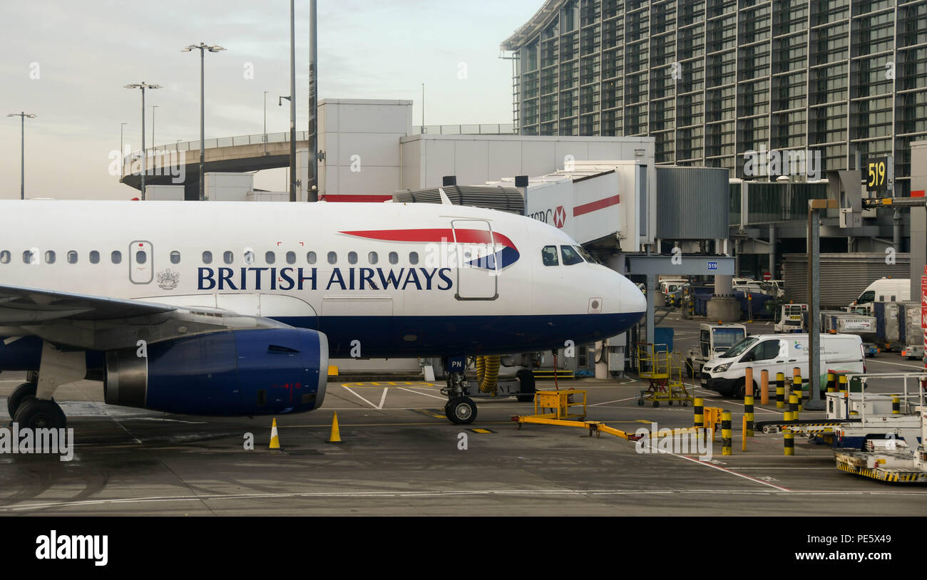 British Airways Airbus A319 short haul aircraft parked at terminal 5 at at London Heathrow Airport - Stock Image