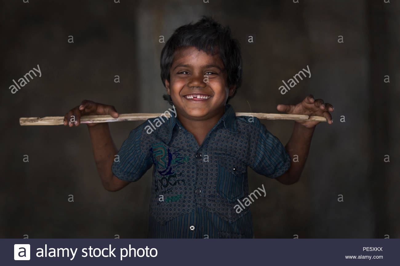 SARNESWAR, RAJASTHAN, INDIA - MARCH 17, 2016, Unidentified Happy Indian rural boy holding old Stick and love to boy poses for camera at Village, Sarne Stock Photo