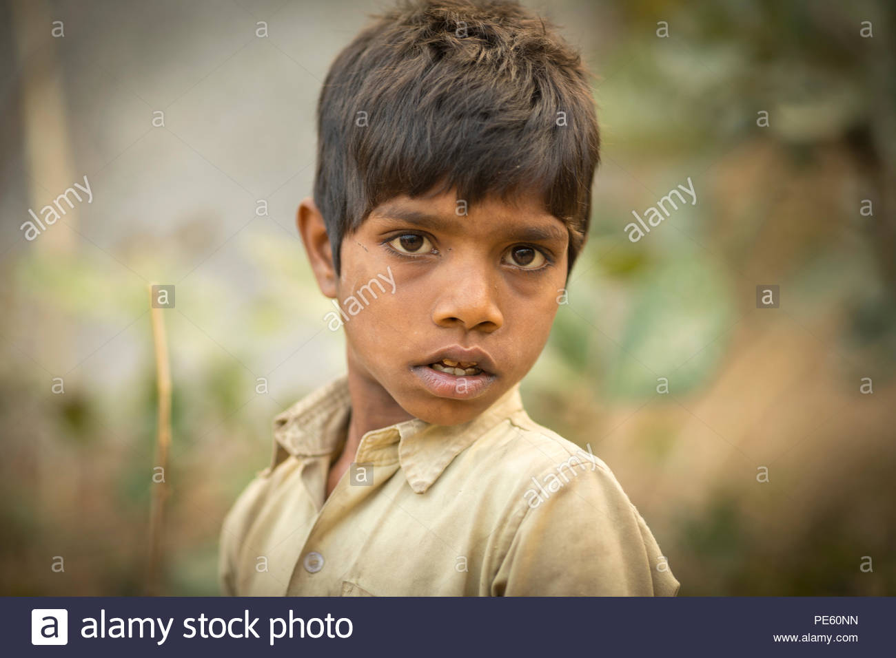 SARUPGANJ, RAJASTHAN, INDIA - JAN 09, 2017 ; An unidentified Indian boy in Village happy to poses for camera, Sarupganj, Rajasthan-India on Jan 09, 20 - Stock Image