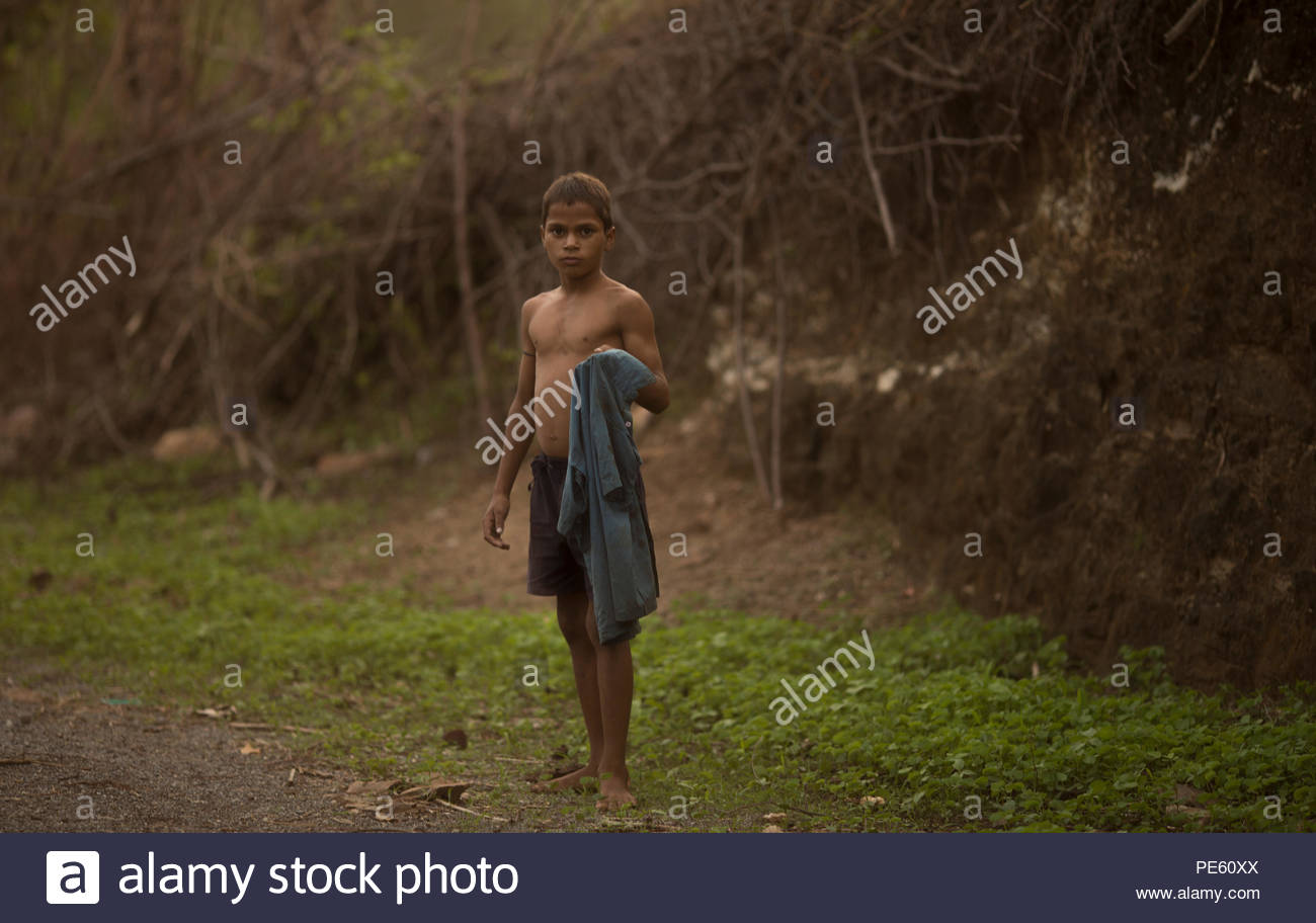 SARUPGANJ, RAJASTHAN, INDIA - JULY 04, 2016 ; An unidentified Indian boy in School uniform happy to poses for camera, Sarupganj, Rajasthan-India on Ju - Stock Image