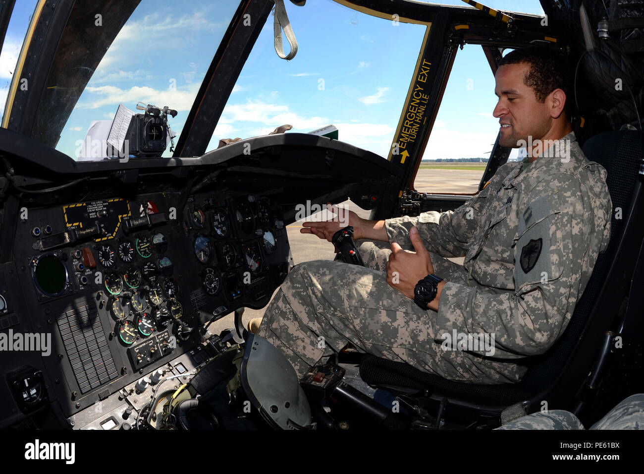 U.S. Army 1st Lt. T.J. Rose, a pilot with the South Carolina Army National Guard's 2-238th General Support Aviation Battalion Detachment 1, performs pre-flight checks on a Boeing CH-47 Chinook helicopter at McEntire Joint National Guard Base, S.C., during a statewide flood response, Oct. 6, 2015. The South Carolina National Guard has been activated to support state and county emergency management agencies and local first responders as historic flooding impacts counties statewide. Currently, more than 2,200 South Carolina National Guard members have been activated in response to the floods. (U. Stock Photo