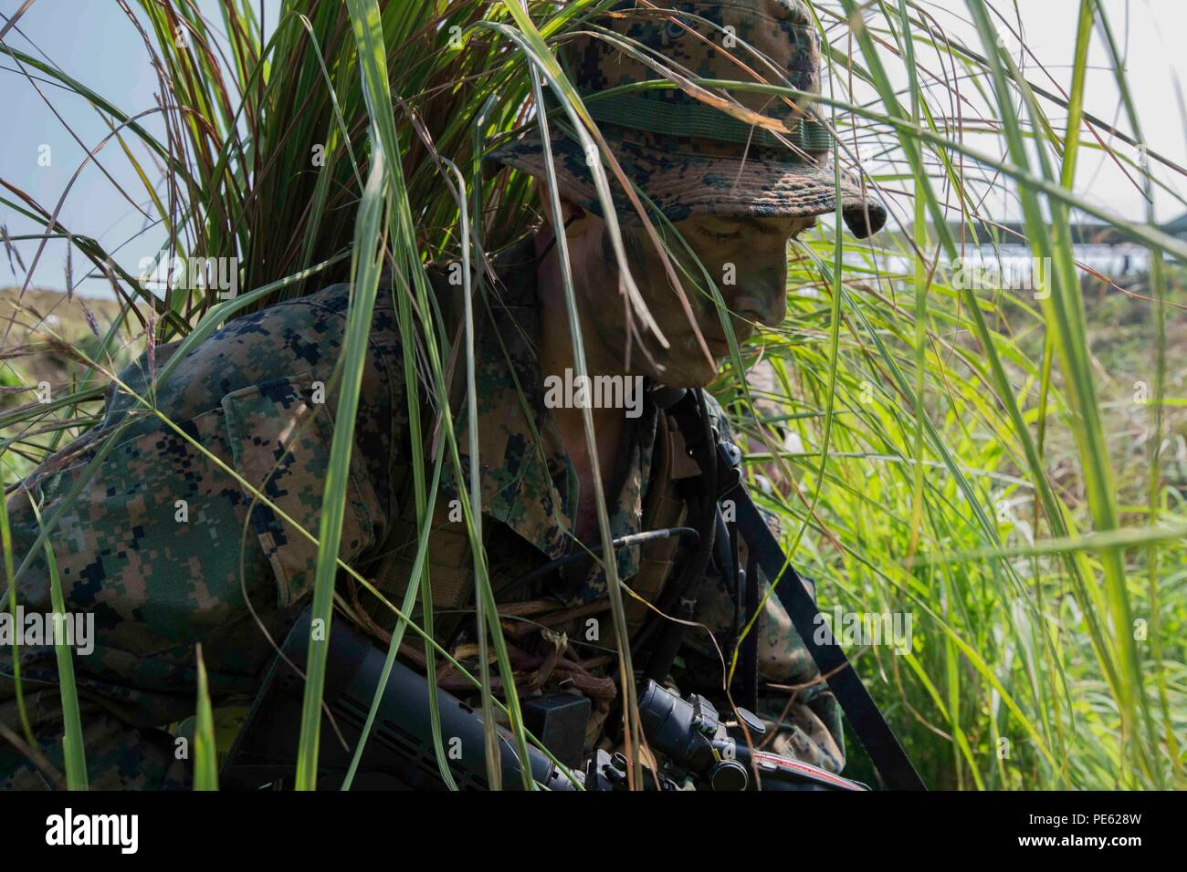 U.S. Marine Corps Cpl. Ryan W. Grim radio operator with 3rd Reconnaissance Battalion, currently attached to 3rd Marine Expeditionary Brigade, moves to consolidate with the assaulting element during an amphibious raid at Ternate, Philippines, as a part of Amphibious Landing Exercise 2015 (PHIBLEX 15), Oct. 8. PHIBLEX 15 is an annual bilateral training exercise conducted with the Armed Forces of the Philippines in order to strengthen our interoperability and working relationships across a wide range of military operations from disaster relief to complex expeditionary operations. (U.S. Marine Cor Stock Photo
