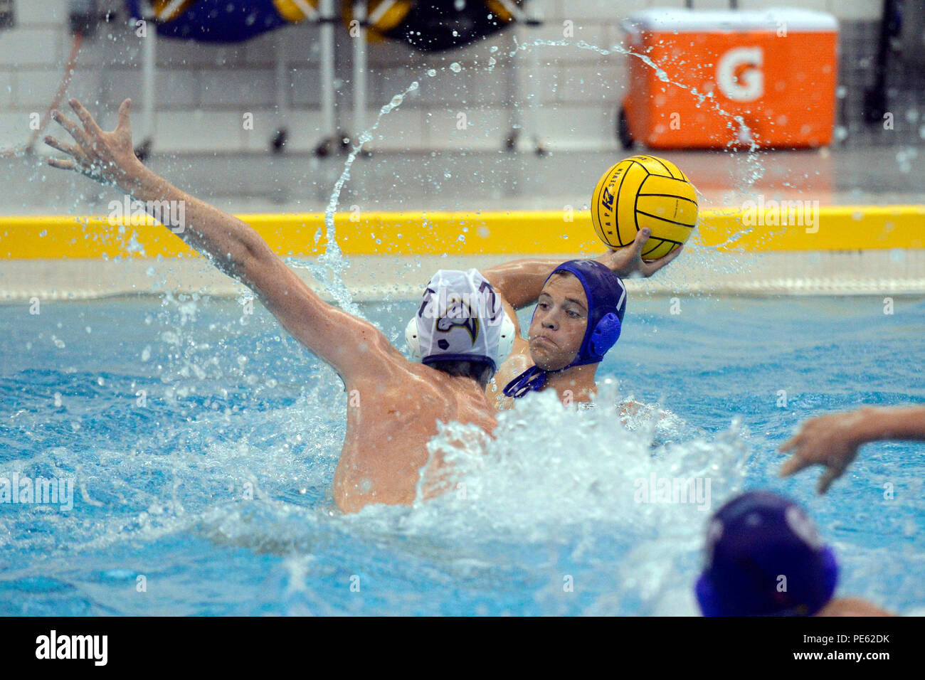 Robby Stiefel, a junior, passes against U.C. Davis as the U.S. Air Force Academy Falcons met the Aggies in a Western Water Polo Association game at the Cadet Natatorium in Colorado Springs, Colo., Oct. 3, 2015. U.C. Davis defeated Air Force 11-10 in triple overtime. (Air Force photo/Bill Evans) - Stock Image