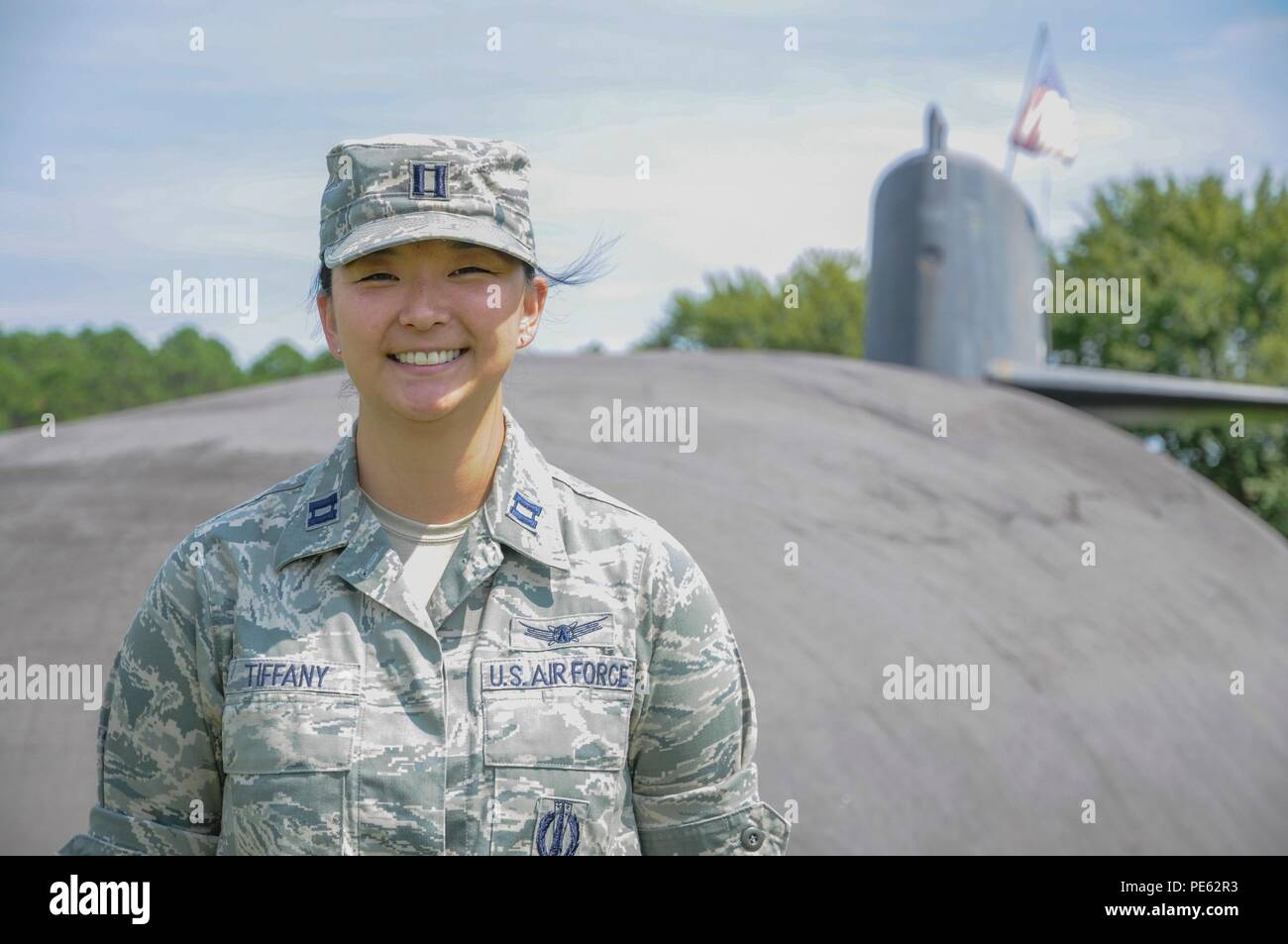 U.S. Air Force Capt. Jessica Tiffany poses for a photo at Naval Submarine Base Kings Bay, Ga., Sept. 22, 2015. Tiffany is one of the first four Air Force intercontinental ballistic missile (ICBM) officers selected to serve with U.S. Navy Submarine Forces (SUBFOR) ballistic missile submarine (SSBN) units through the Striker Trident nuclear officer exchange program. In May, she left the 341st Missile Wing at Malmstrom Air Force Base, Mont., to begin a three-year assignment as a strategic targeting assistant in the strategic forces, nuclear weapons and force protection directorate at Commander, S - Stock Image