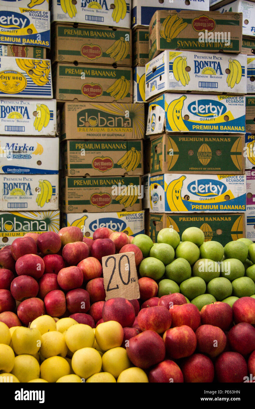 SKOPJE, MACEDONIA - OCTOBER 24, 2015: Apples, Yellow, Red and Green, for sale in Skopje Bazaar, in front of cardboard boxes full of other fruits  Pict - Stock Image