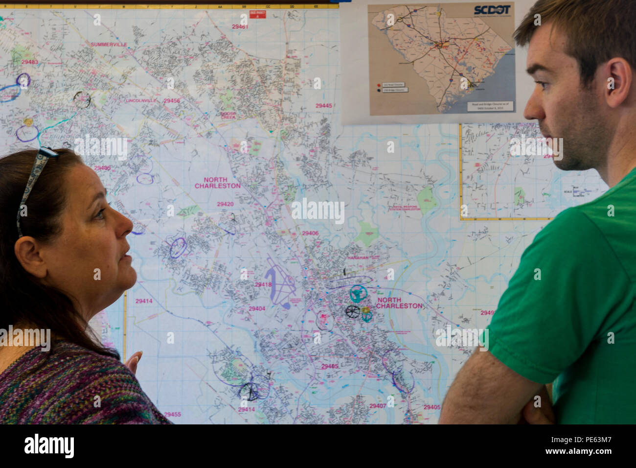 Terry Kornahrens, disaster assessment lead for the Palmetto SC Region of the American Red Cross, and Jason Trinklein, a Red Cross volunteer from New York, discuss flood-relief operations Oct. 8, 2015, in North Charleston, S.C. The historic flooding, which caused damage, destruction and death throughout South Carolina, was the result of record-setting rainfall during what was considered a 1,000-year rain event delivered by Hurricane Joaquin as it went up the East Coast. The Palmetto SC Region of the American Red Cross provides services to residents of South Carolina including disaster relief, h - Stock Image