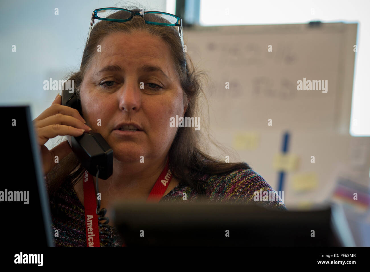 Terry Kornahrens, disaster assessment lead for the Palmetto SC Region of the American Red Cross, discusses flood relief efforts at a Red Cross emergency operations center Oct. 8, 2015, in North Charleston, S.C. The historic flooding, which caused damage, destruction and death throughout South Carolina, was the result of record-setting rainfall during what was considered a 1,000-year rain event delivered by Hurricane Joaquin as it went up the East Coast. The Palmetto SC Region of the American Red Cross provides services to residents of South Carolina including disaster relief, health and safety - Stock Image
