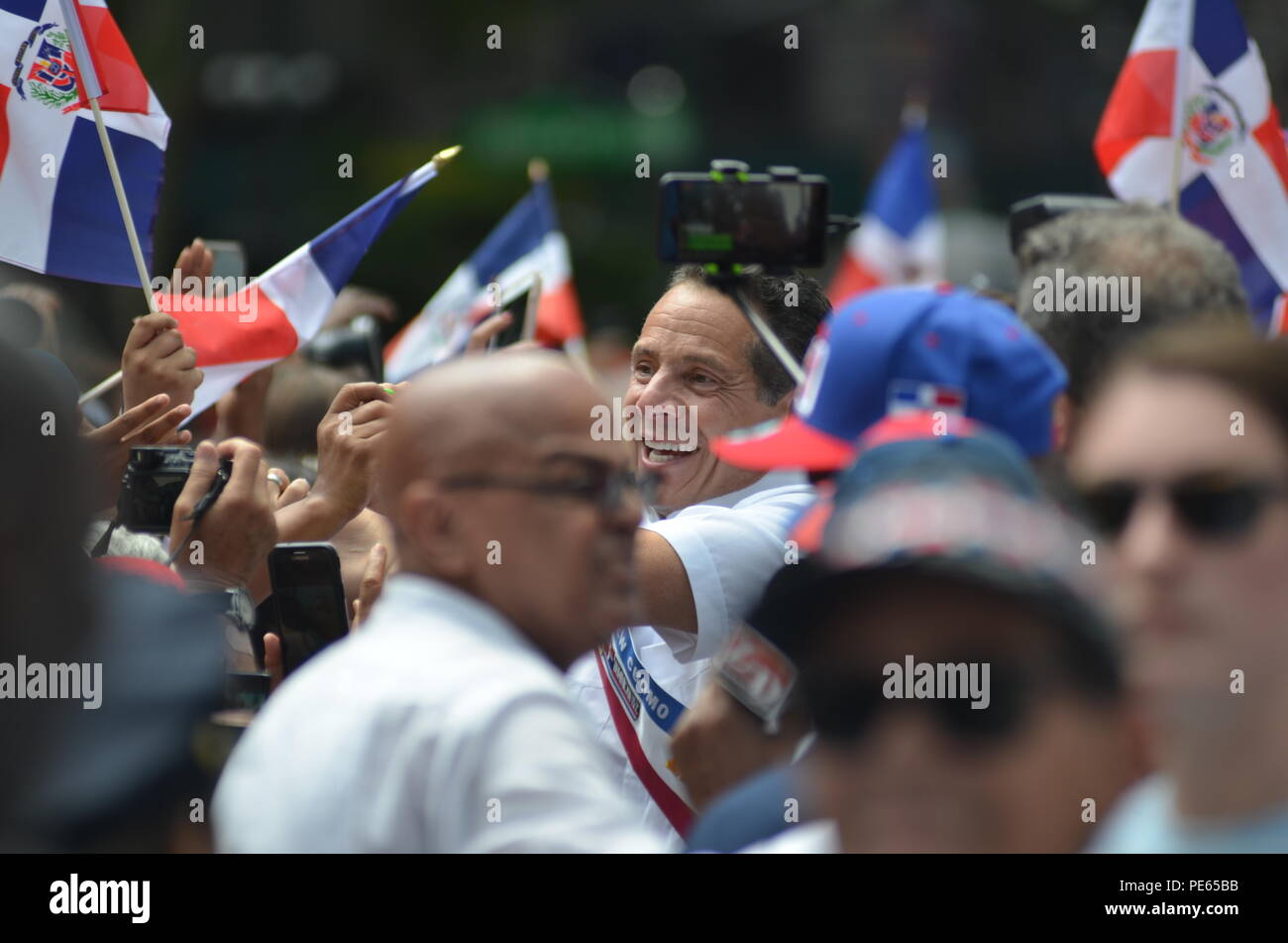 New York, USA. 12th Aug, 2018.New York Governor Andrew Cuomo attends the Dominican Day Parade in New York, the United States. Dominican Day is a festive occasion celebrating Dominican tradition, heritage and folklore in the streets of New York. Credit: Ryan Rahman/Alamy Live News - Stock Image