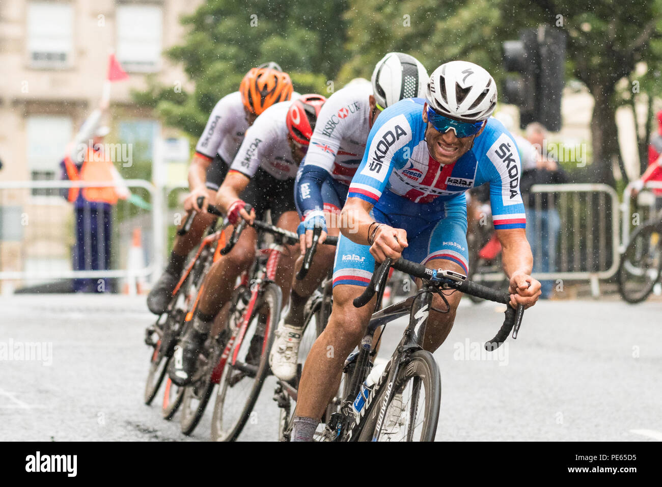 Glasgow, Scotland, UK - 12 August 2018: European Championships 2018 - difficult conditions in the rain for competitors in the European Championships men's road race in Glasgow Credit: Kay Roxby/Alamy Live News - Stock Image