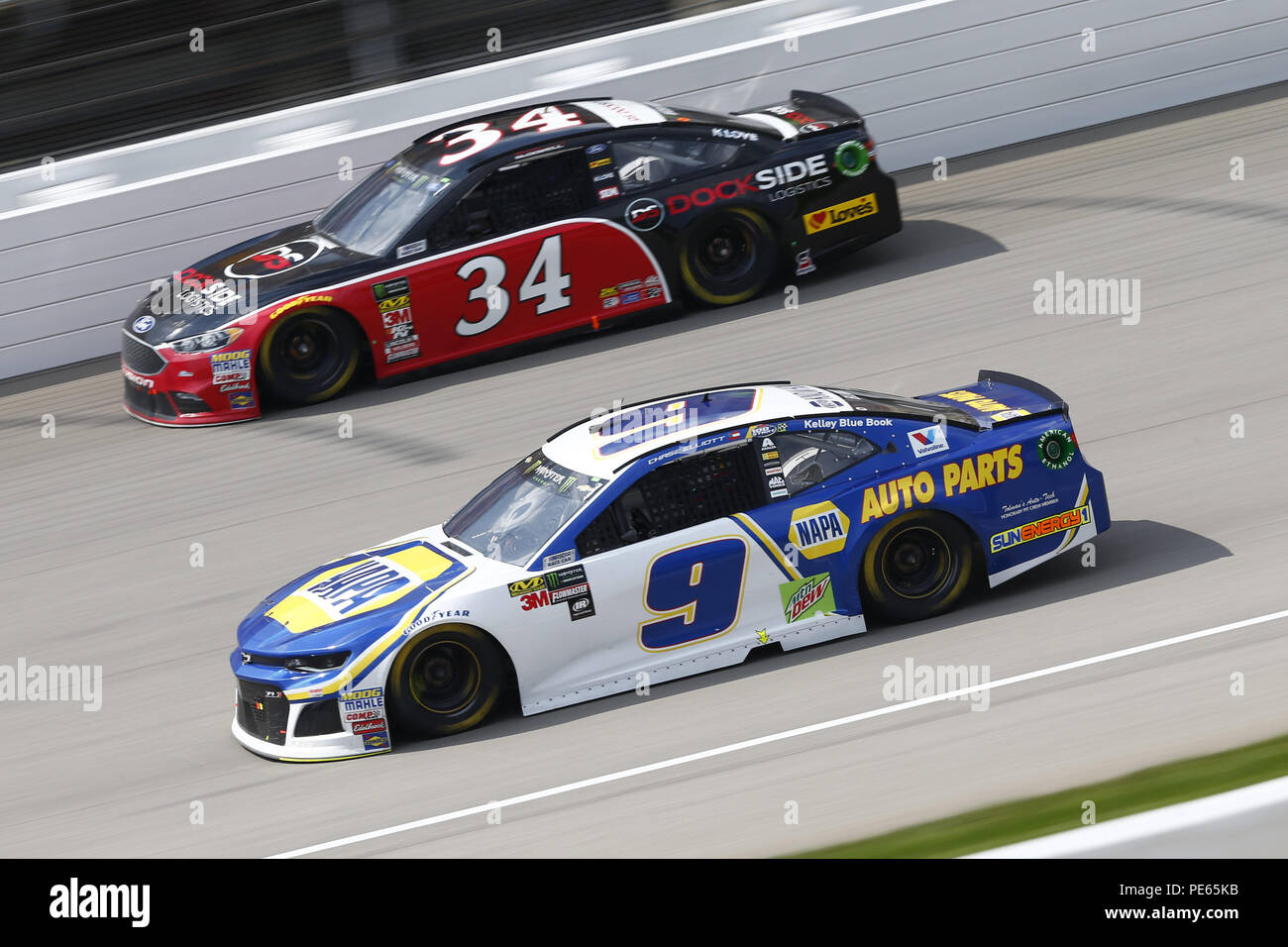 Brooklyn, Michigan, USA. 12th Aug, 2018. Chase Elliott (9) and Michael McDowell (34) battle for position during the Consumers Energy 400 at Michigan International Speedway in Brooklyn, Michigan. Credit: Chris Owens Asp Inc/ASP/ZUMA Wire/Alamy Live News - Stock Image