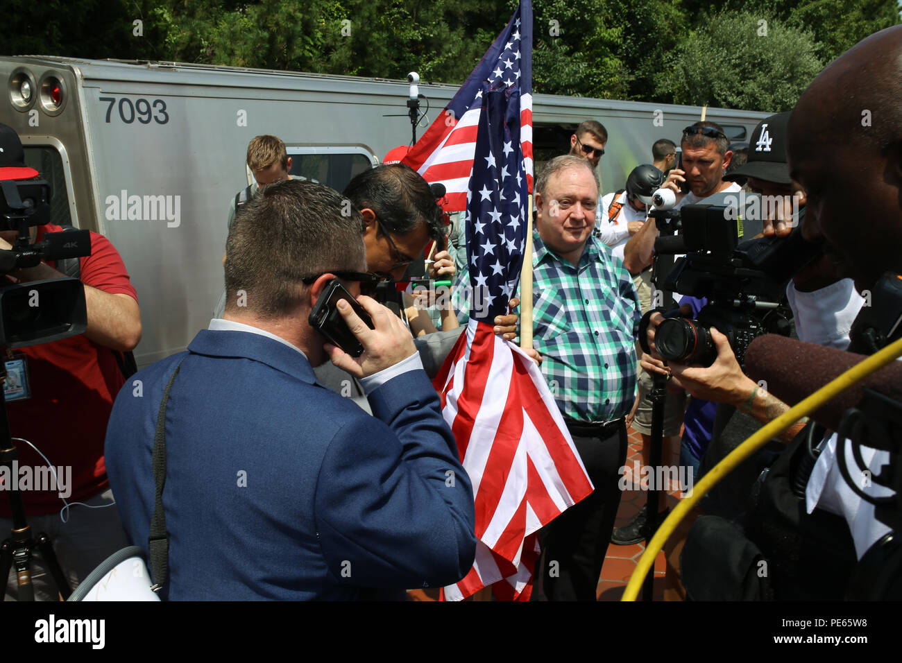 Washington, DC, USA. 12 Aug 2018. Jason Kessler, leader of the white nationalist Unite the Right protest, coordinating with Park Police after being told poles would need to be removed from flags Credit: Joseph Gruber/Alamy Live News - Stock Image