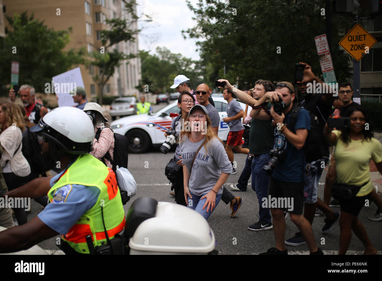 Washington, DC, USA. 12 Aug 2018. Counterprotestors at the Unite the Right  protest march along with the police escort voicing their anger at the  protestors.