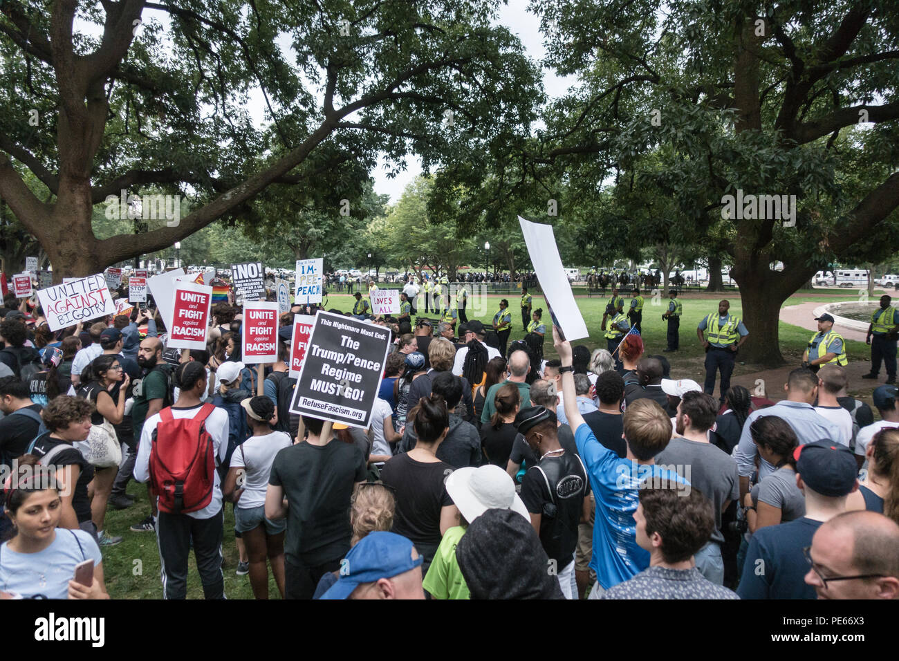 Washington, DC, USA. 12th August, 2018.   Some of the thousands of demonstrators at a counter-protest in Lafayette Square, while only a handful of white nationalists held their Unite the Right rally nearby in front of the White House (seen in distance center of photo among camera crews) on the one year anniversary of the violent Charlottesville, Virginia rally. Bob Korn/Alamy Live News Stock Photo