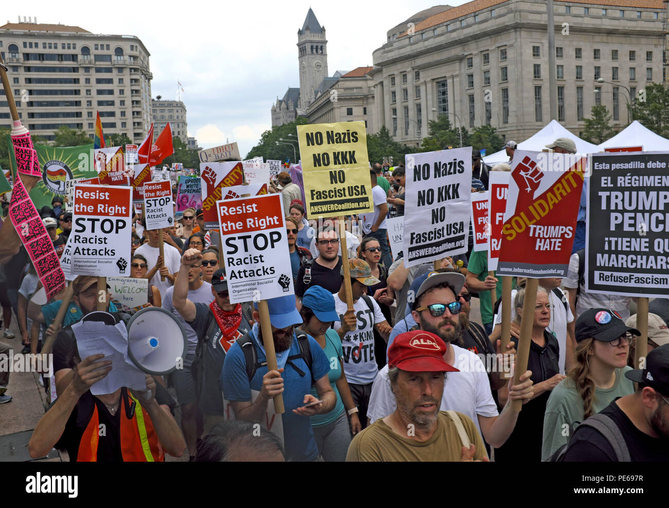 Washington D.C., USA. 12th August, 2018.Counterprotesters marching against the alt-right and white nationalism leave Freedom Park in Washington DC to march through the streets.  Resist the right, no kkk, stop racial attacks, solidarity Trumps hate, and Trump Pence regime sign are all signs transparent in the crowd of marchers making their way to Lafayette Park.  Credit: Mark Kanning/Alamy Live News Stock Photo