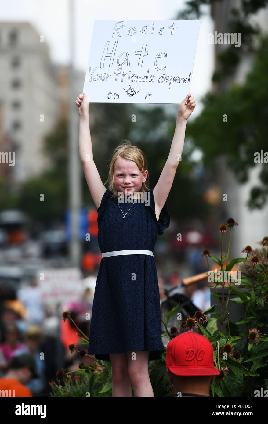 Washington, USA  12th Aug, 2018  A girl holds a poster at the