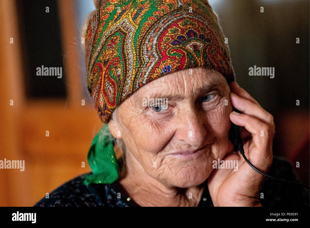 South Ossetia. 11th Aug, 2018. SOUTH OSSETIA - AUGUST 11, 2018: Margarita Madzigova, 63, poses at home in the village of Khetagurovo, Tskhinvali District, South Ossetia; Margarita and her husband Alikhan have been running a farm since their house was restored after the 2008 South Ossetian-Georgian military conflict. Sergei Bobylev/TASS Credit: ITAR-TASS News Agency/Alamy Live News - Stock Image
