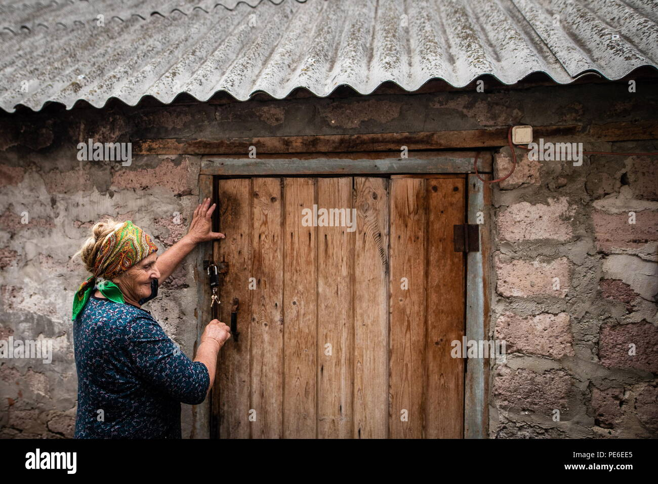 South Ossetia. 11th Aug, 2018. SOUTH OSSETIA - AUGUST 11, 2018: Margarita Madzigova, 63, outside her house in the village of Khetagurovo, Tskhinvali District, South Ossetia; Margarita and her husband Alikhan have been running a farm since their house was restored after the 2008 South Ossetian-Georgian military conflict. Sergei Bobylev/TASS Credit: ITAR-TASS News Agency/Alamy Live News - Stock Image