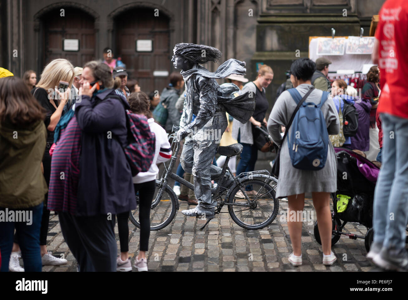 Edinburgh, Scotland UK. 13th August 2018. A motionless busker entertains tourists on the Royal Mile in the Old Town of Edinburgh. Ben Collins/Alamy Live News Stock Photo