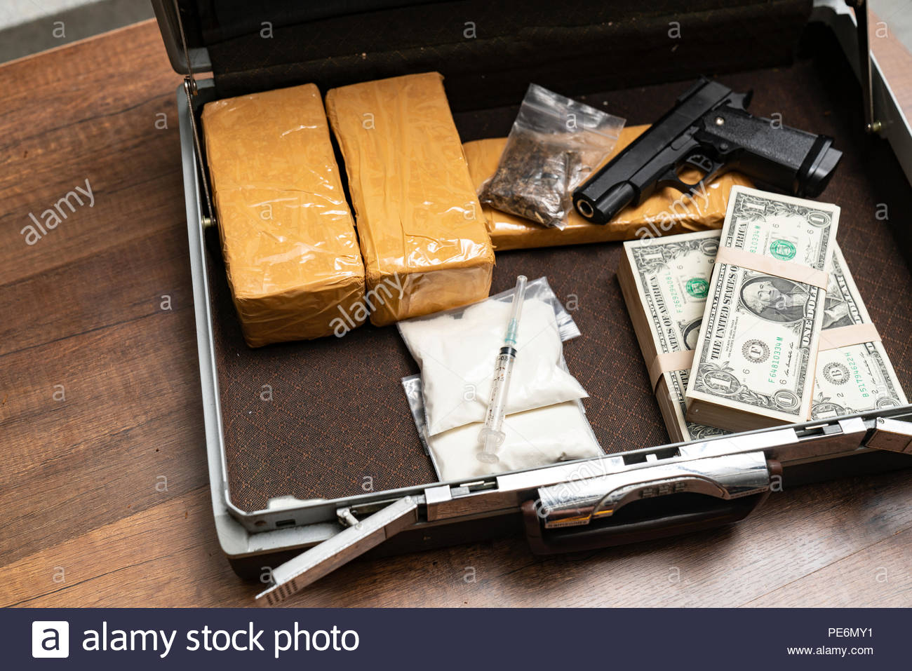 Drug syringe and cooked heroin - Stock Image