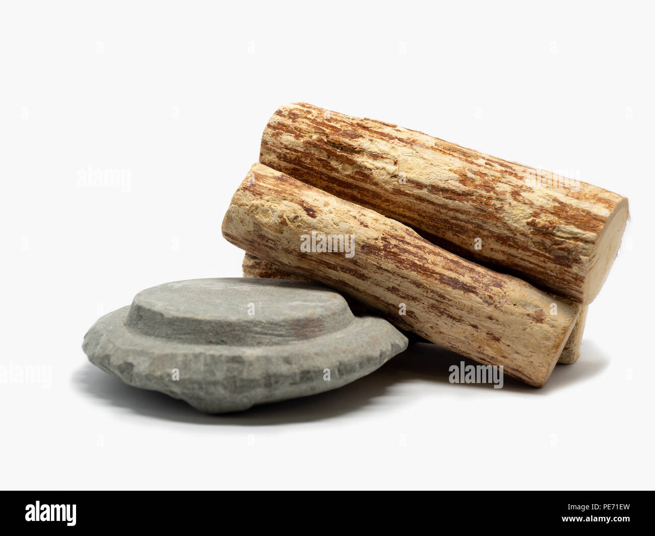 Thanaka wood and Kyauk pyin stone slab on white background (Isolated background). The Tanaka is popular with Burmese women. The face to make a beautif - Stock Image