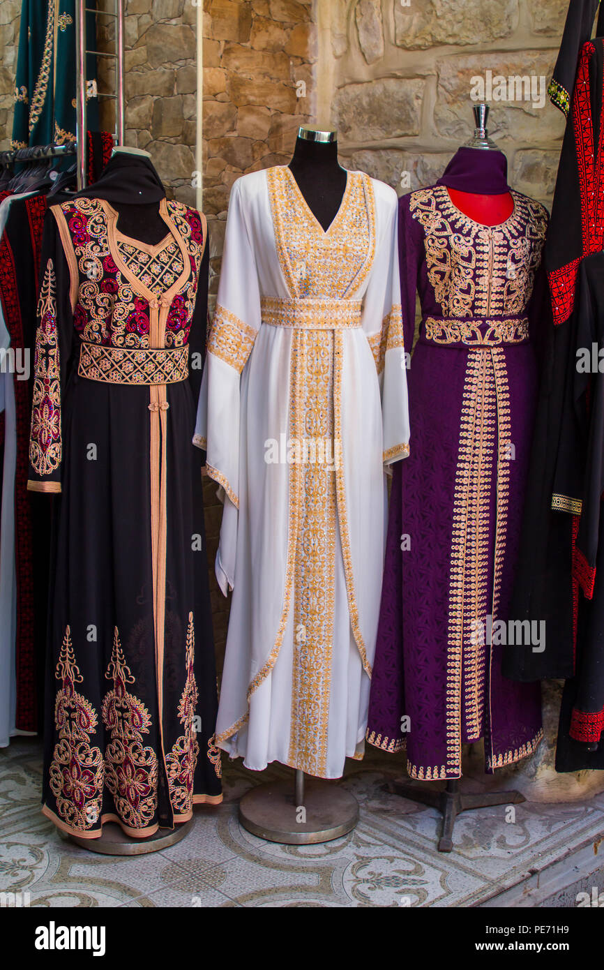 Israel 11 May 2018. Full length Muslim Kaftan Gowns on display in a small shop window in the Old Town Jerusalem Arab Bazaar - Stock Image