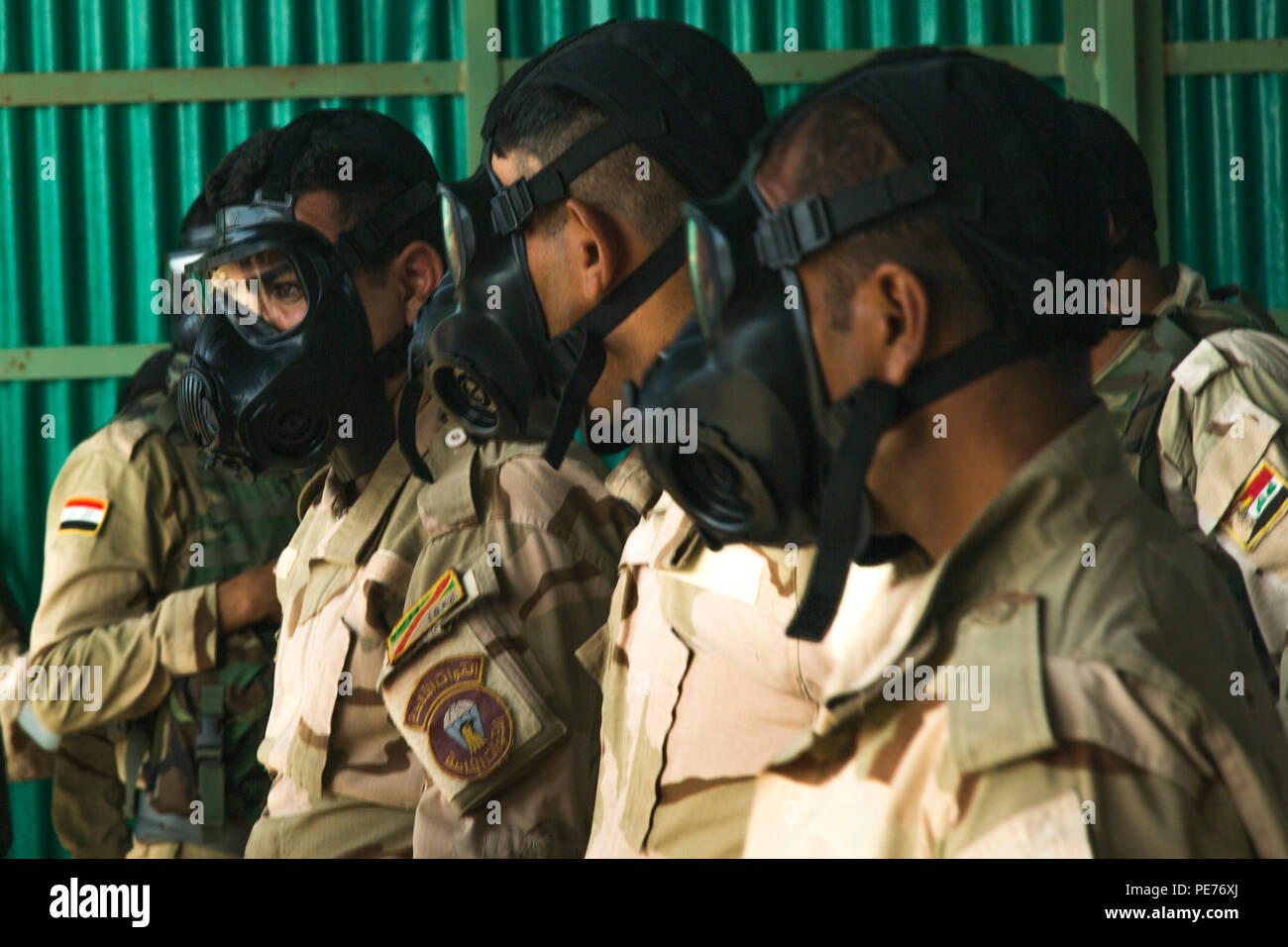 Iraqi Soldiers Assigned To The 71st Iraqi Army Brigade Listen To