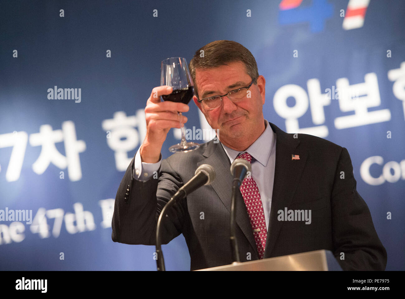 Secretary of Defense Ash Carter toasts Republic of Korea Minister of Defense Minkoo Han during the Security Consultative Meeting reception in Seoul, South Korea, Nov. 1, 2015, as part of his Asia-Pacific trip. During the trip, the secretary will meet with leaders from more than a dozen nations across East Asia and South Asia to help advance the next phase of the U.S. military's rebalance in the region by modernizing longtime alliances and building new partnerships.   (Photo by Senior Master Sgt. Adrian Cadiz)(Released) Stock Photo