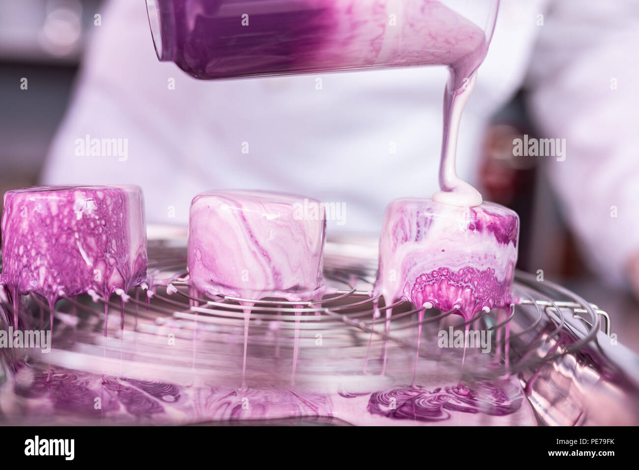 Master of confectionary finishing her extraordinary blueberry cakes - Stock Image