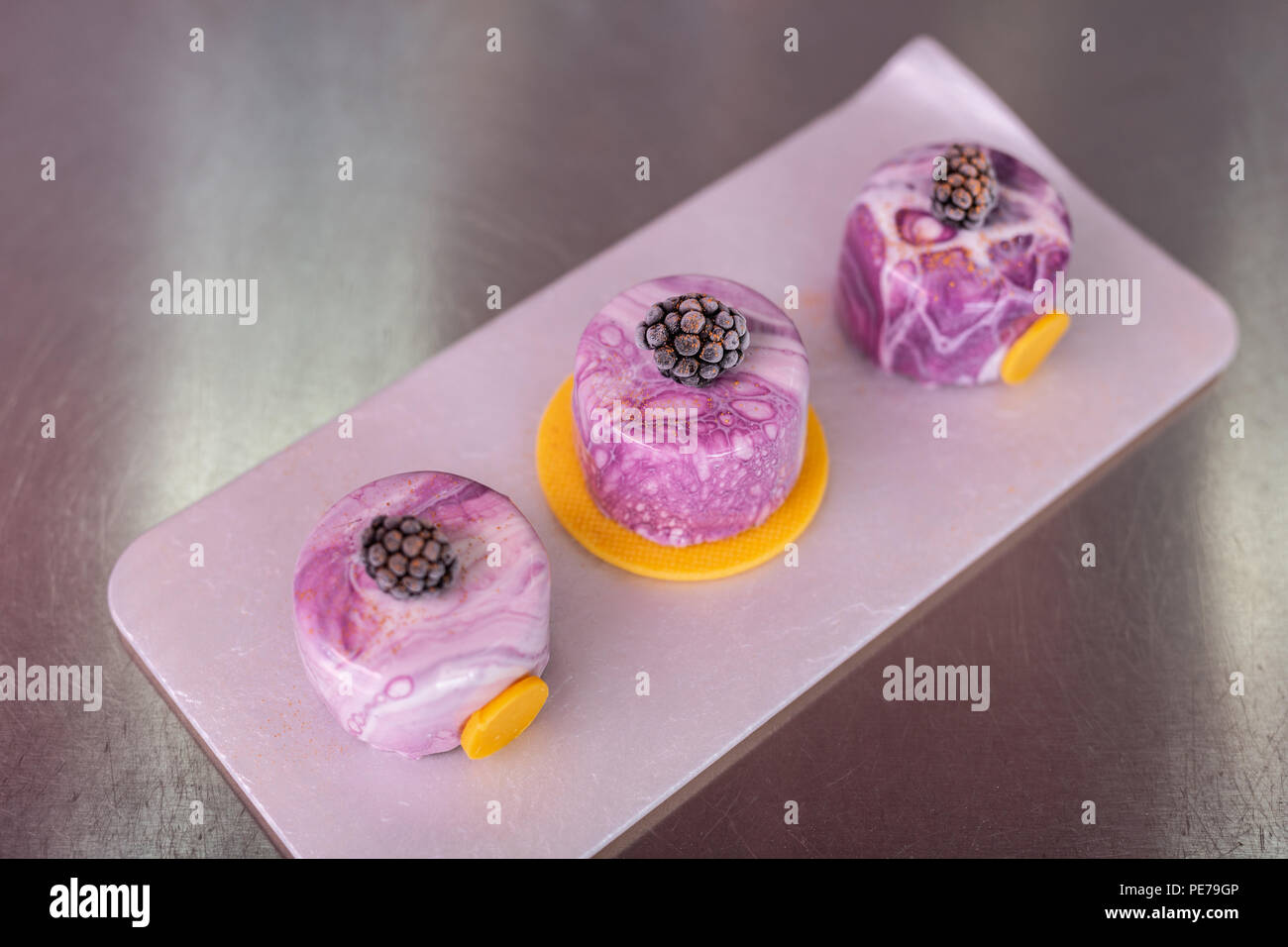 Top view of perfect blueberry cakes with mirror icing - Stock Image