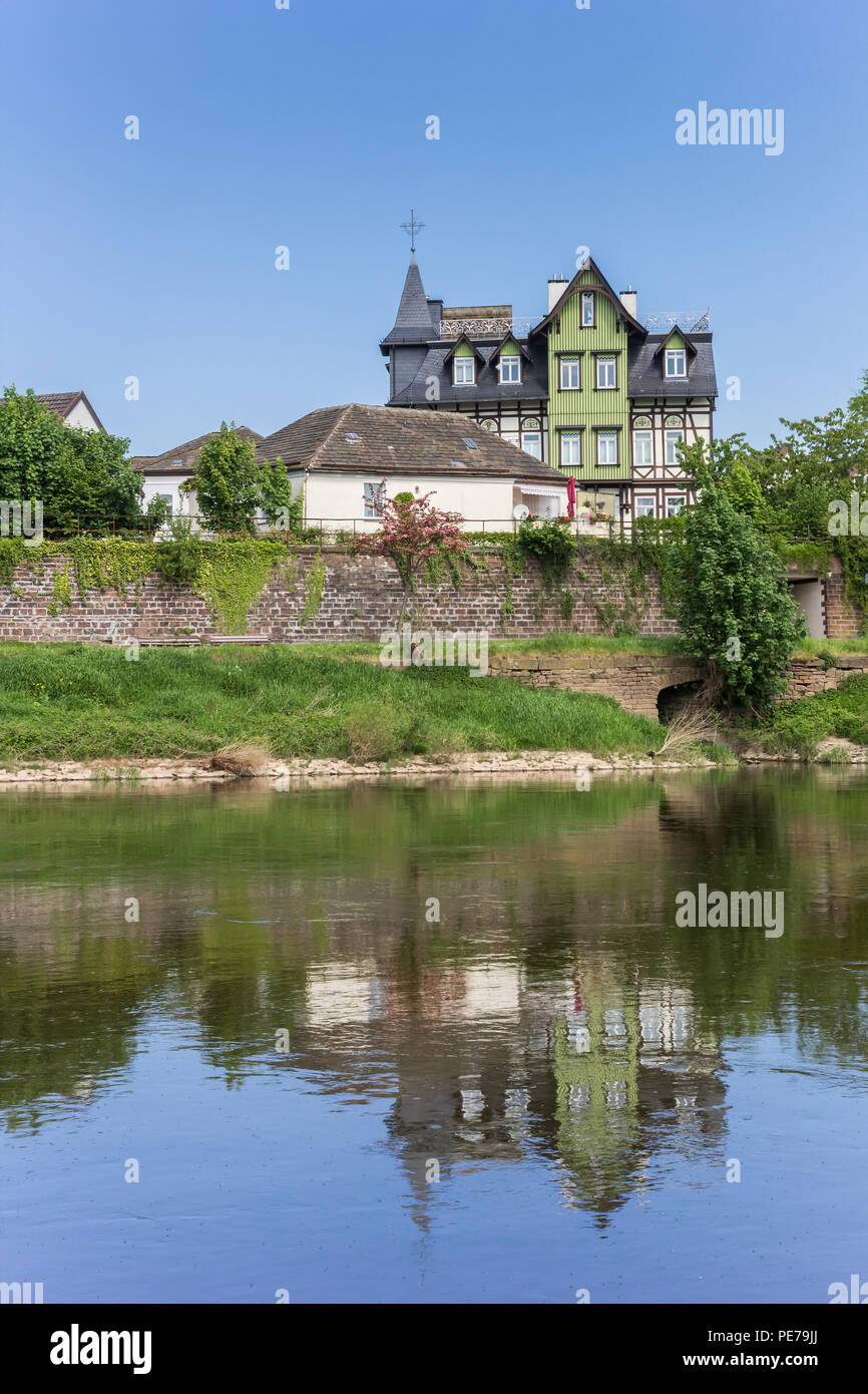 Traditional house at the Weser river in Hoxter, Germany Stock Photo