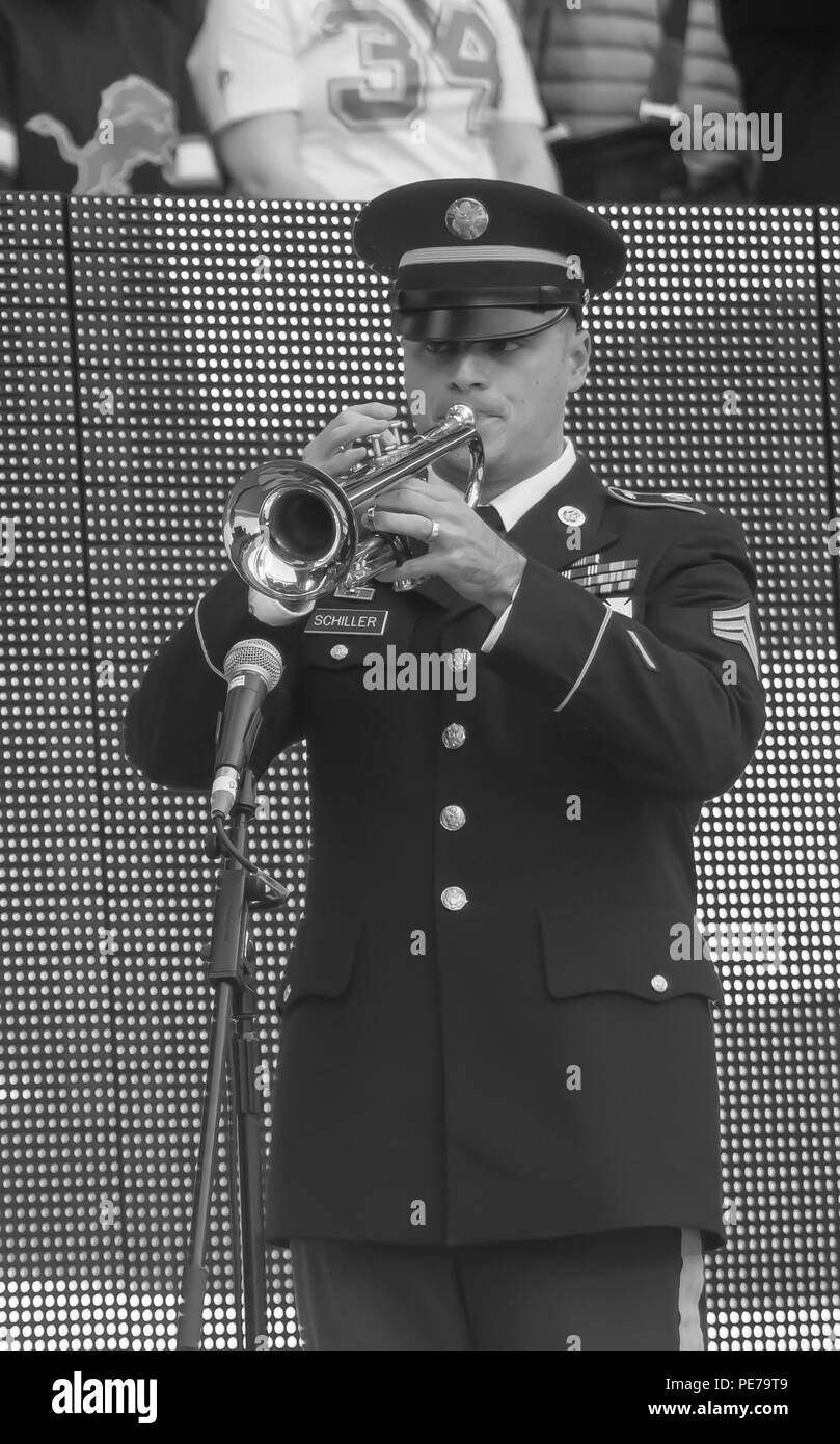 A U.S. Army Europe Band and Chorus member performs for a crowd of more than 83,000 before the NFL International Series Game in London, Nov. 1, 2015. The USAREUR Band & Chorus performs more than 200 missions each year, and has appeared in more than 20 European, Middle Eastern and North African countries in the last decade. (U.S. Air Force photo/Senior Airman Trevor T. McBride/Released) - Stock Image