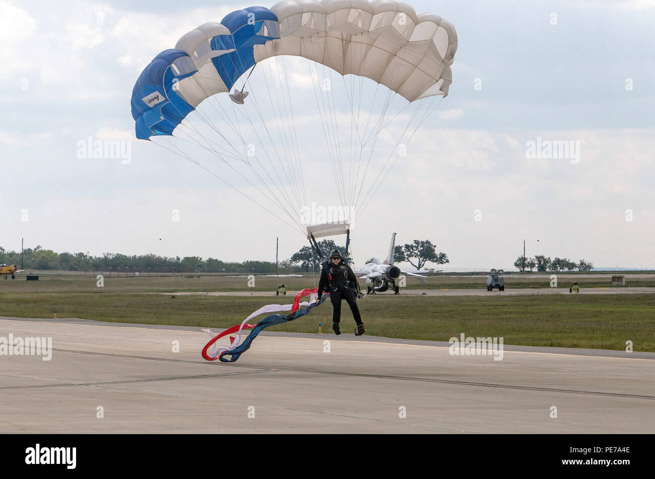 U.S. Air Force Academy Wings of Blue team member lands during the 2015 Joint Base San Antonio Air Show and Open House Nov. 1, 2015 at JBSA-Randolph, Texas. Air shows allow the Air Force to display the capabilities of our aircraft to the American taxpayer through aerial demonstrations and static displays and allowing attendees to get up close and personal to see some of the equipment and aircraft used by the U.S. military today. (U.S. Air Force photo by Johnny Saldivar) Stock Photo