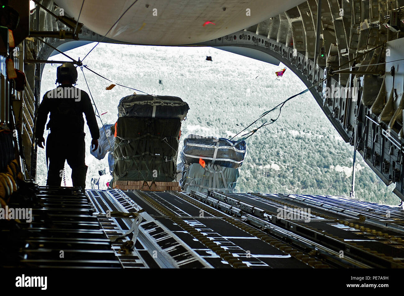 Cargo For The 82nd Airborne Division Is Air Dropped Out Back Of A C