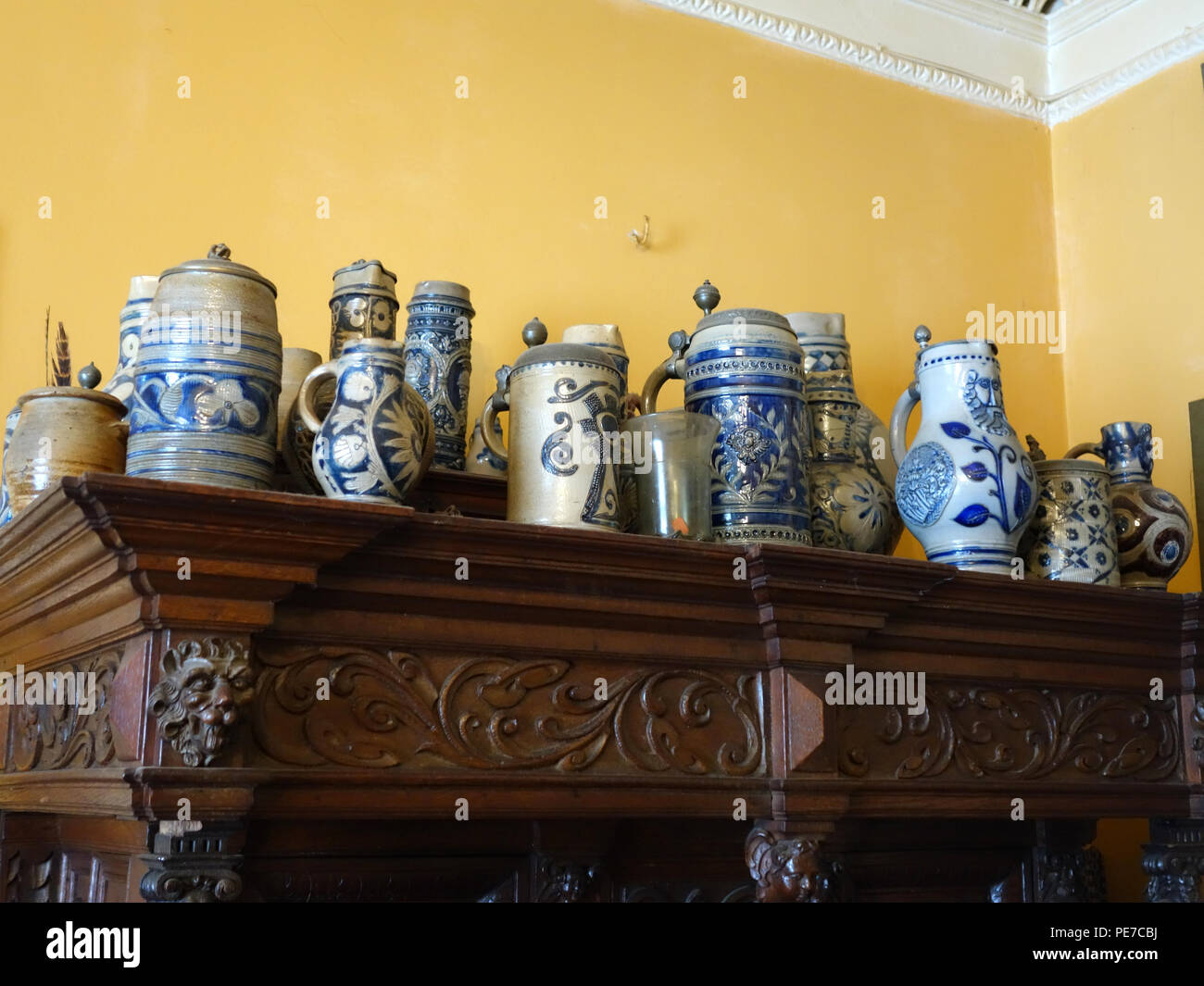 Collection of old German stoneware beer jugs and tankards - Stock Image
