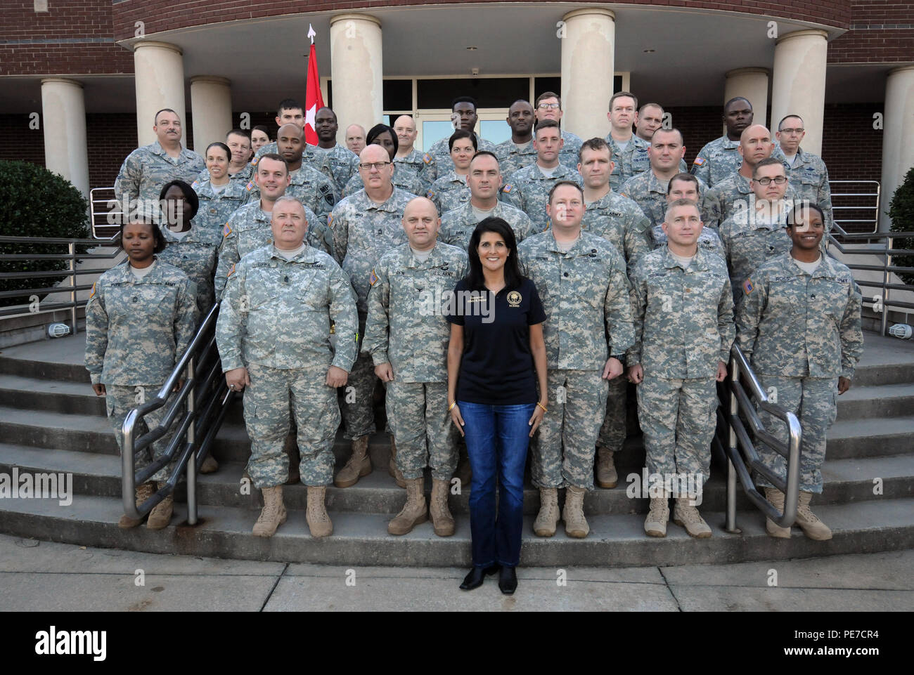South Carolina Gov. Nikki Haley poses with South Carolina National Guard members during a visit to assess the National Guard response to severe flooding in support of civil authorities, National Guard Readiness Center, West Columbia, S.C., Oct. 14, 2015. (U.S. Army National Guard photo by Sgt. 1st Class Jim Greenhill) (Released) - Stock Image