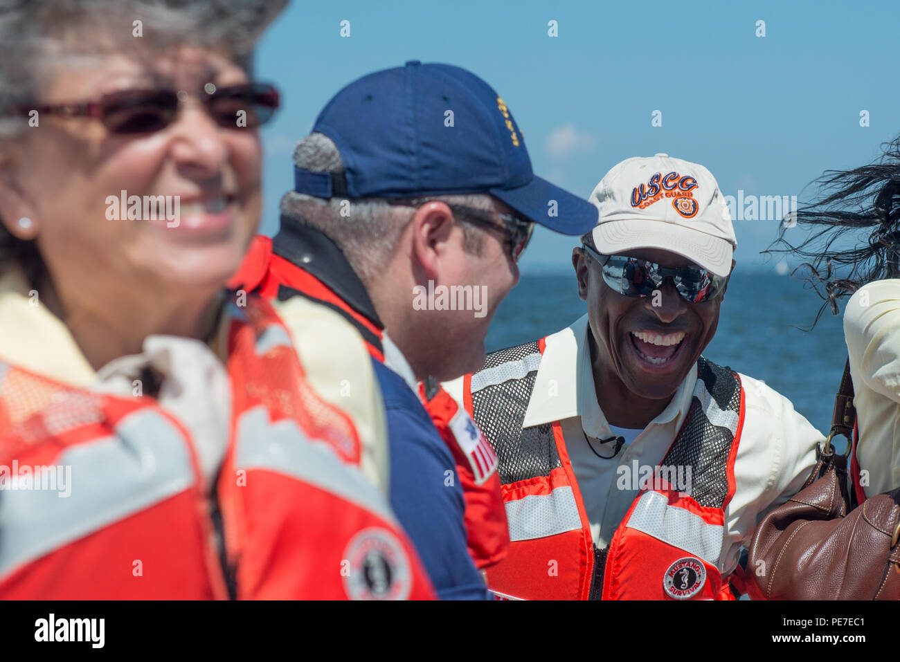 John White shares a laugh with Petty Officer 1st Class James Ables, the public affairs officer at Coast Guard Station Annapolis, on their ride out to the Thomas Point Shoal Lighthouse, Sept. 9, 2015. After his tour aboard the Chincoteague, White was transferred to Annapolis, where, after a year, he moved up to Petty Officer 2nd class and was assigned to be the officer-in-charge of the lighthouse. (U.S. Coast Guard photo by Petty Officer 2nd Class David R. Marin) - Stock Image