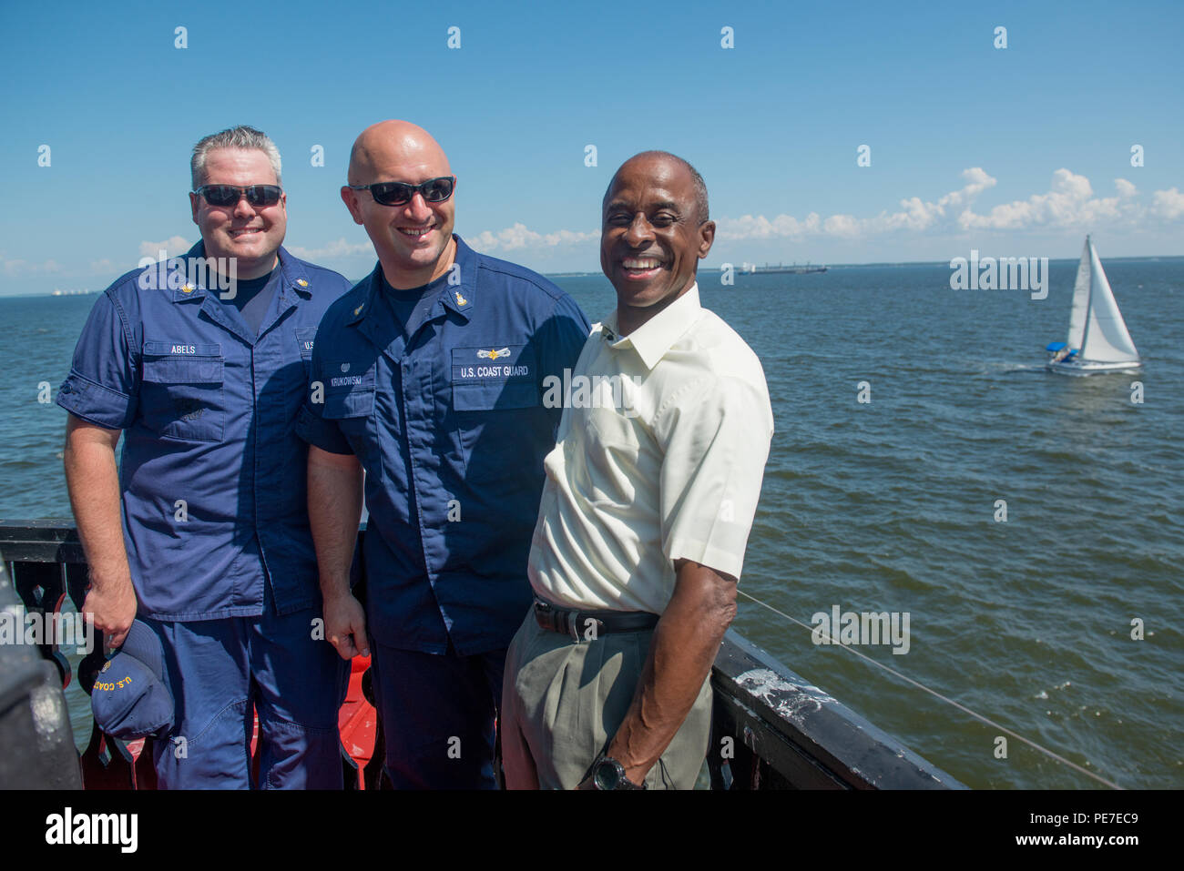 (Left to right) Petty Officer 1st Class James Ables, public affiars officer at station Annapolis, Senior Chief Petty Officer William Krukowski, officer in charge of Coast Guard Station Annapolis, and John White pose for a photo while on the Thomas Point Shoal Lighthouse Sept. 9, 2015. (U.S. Coast Guard photo by Petty Officer 3rd Class David Marin) See more at: http://midatlantic.coastguard.dodlive.mil/2015/10/a-guiding-light/#sthash.QgppGlW7.dpuf - Stock Image