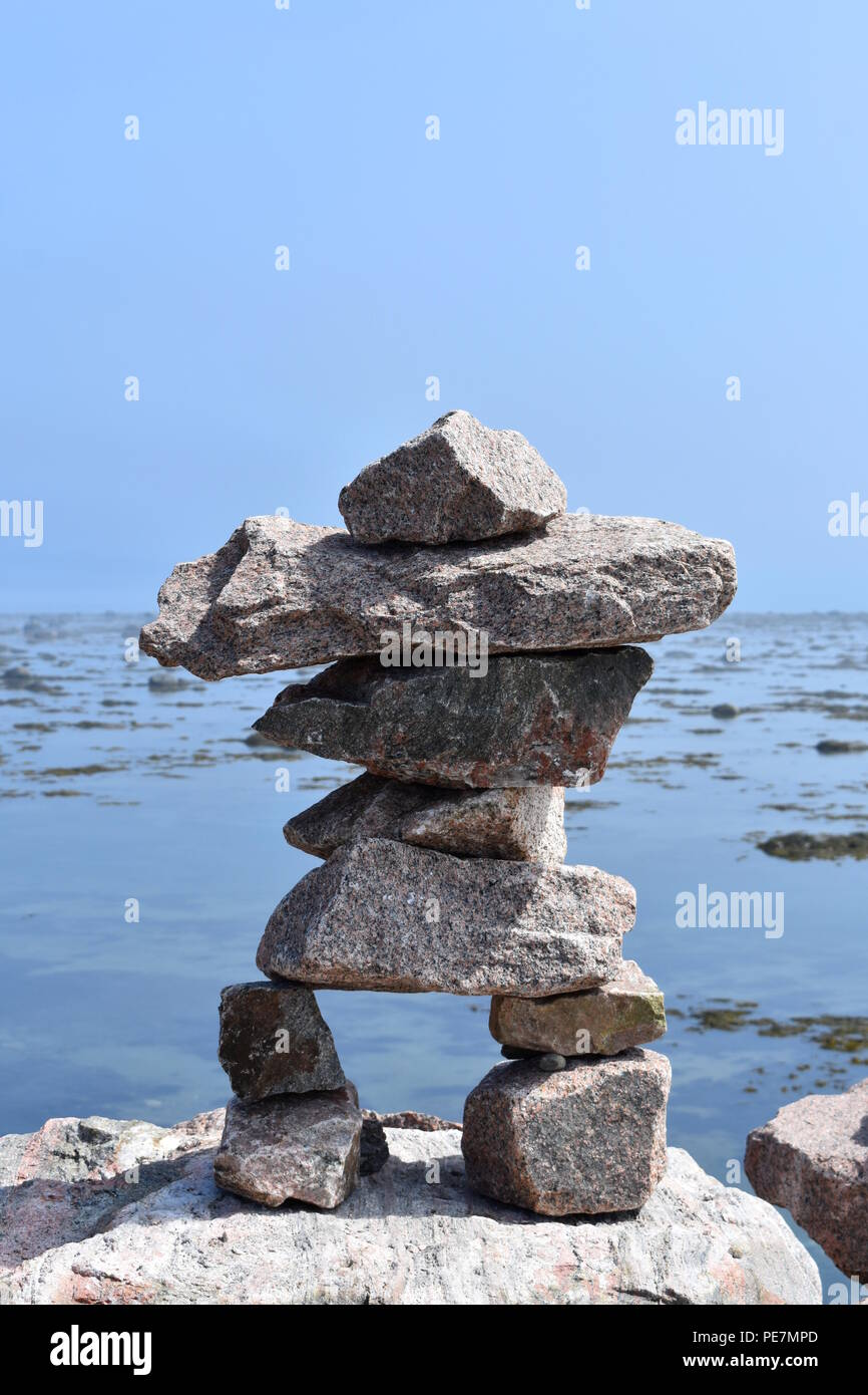 An Inukshuk from the Inuit culture in Quebec, Canada - Stock Image