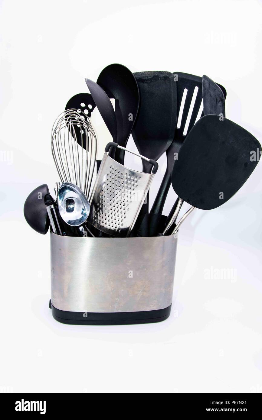 Miscellaneous kitchen utensils in silver container - Stock Image