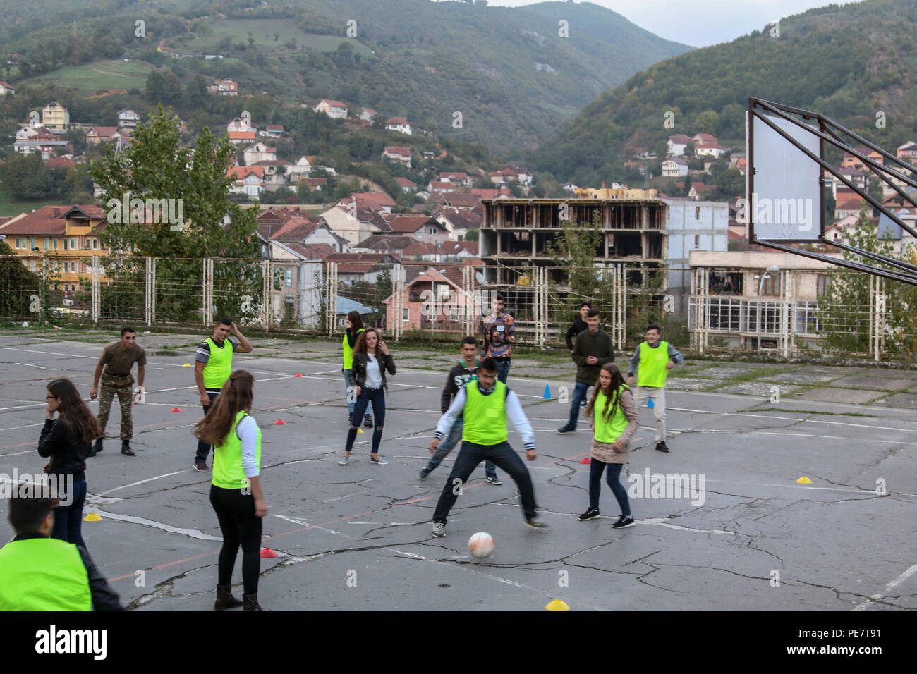 Local students play a soccer-like game used to teach lessons
