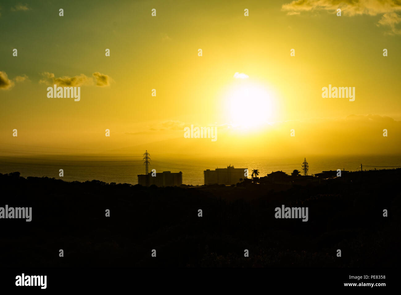 Sunset view to the Playa Paraiso buildings silouettes and ocean - Stock Image