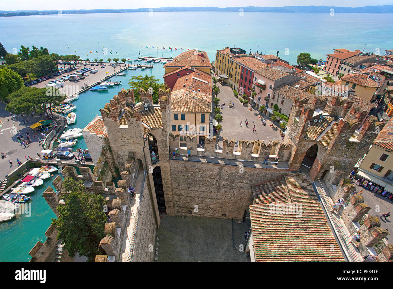 View from Scaliger castle on harbour and old town of Sirmione, Lake Garda, Lombardy, Italy - Stock Image